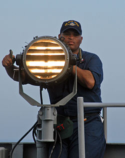 250px-Seaman_send_Morse_code_signals
